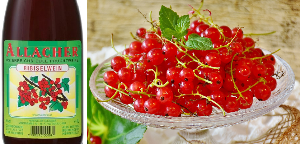 Ribiselwein - bottle and bowl of redcurrant