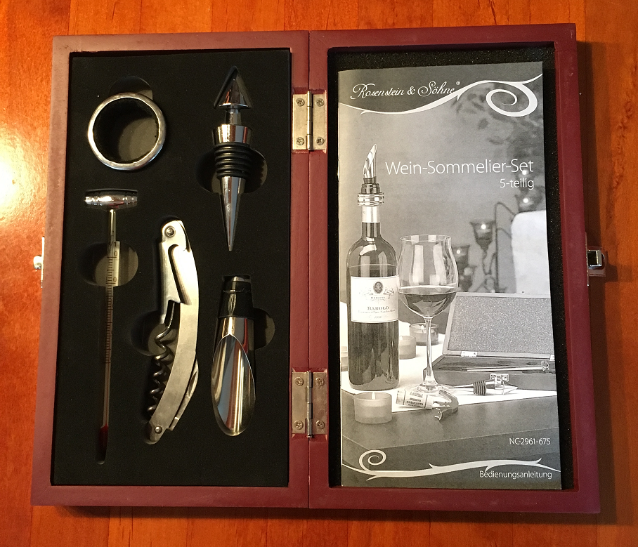 Sommelier set - waiter's knife (with corkscrew and bottle opener), bottle pourer, two wine thermometers (ring for closed and rod for opened bottles) and bottle stopper.