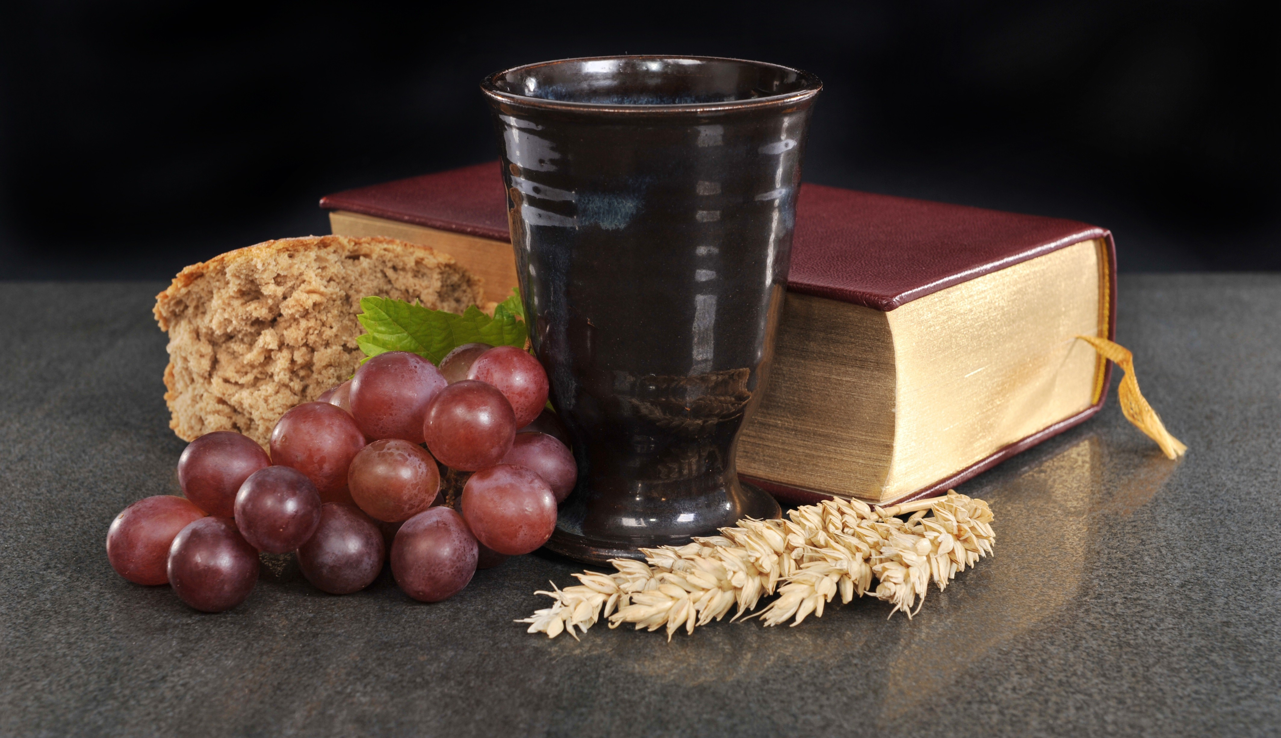Messwein - mug with wine, bread, bunch of grapes and Bible