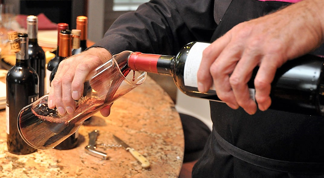 Decanting - pouring from bottle into carafe