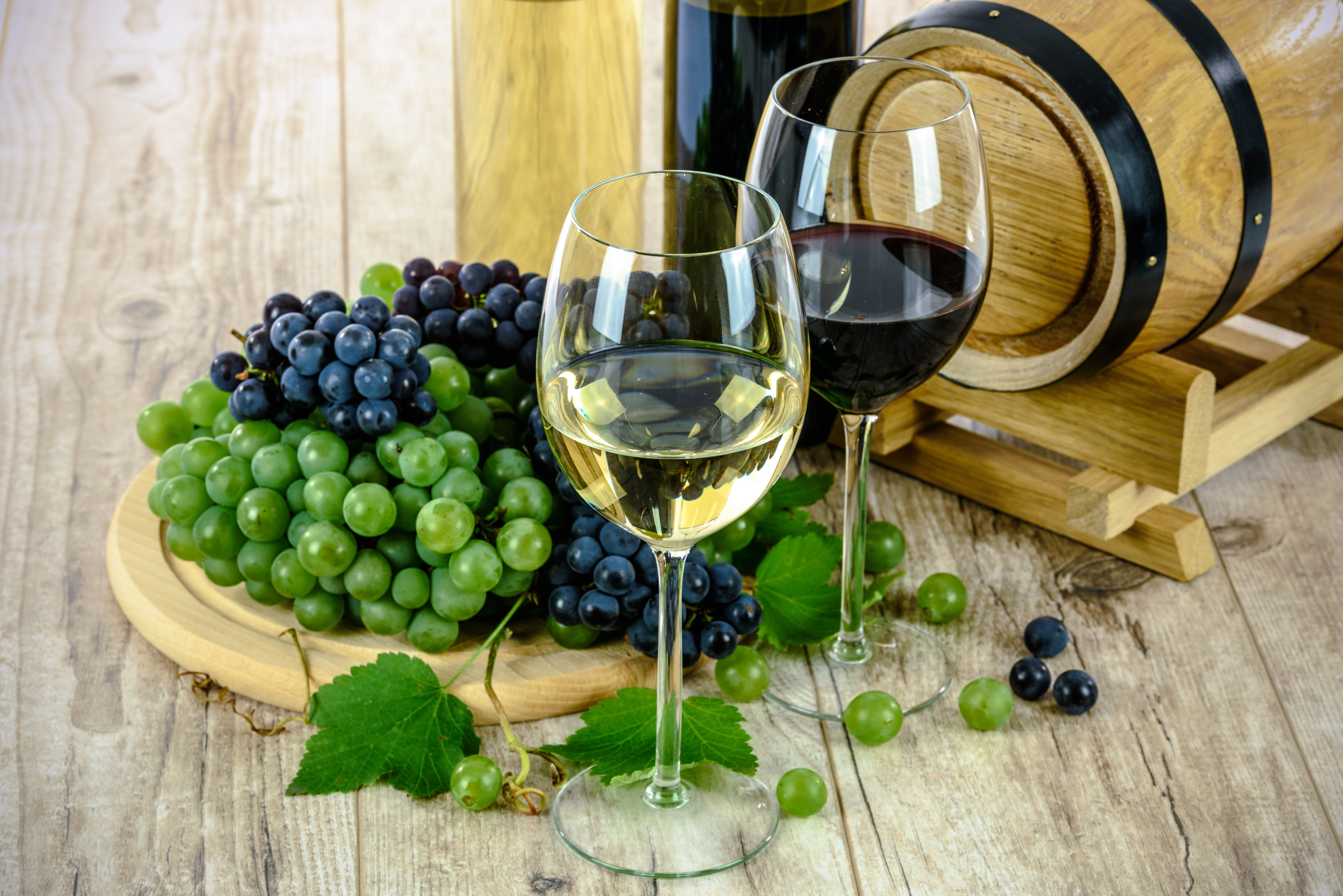 Aging - still life: red wine and white wine in glass and grapes
